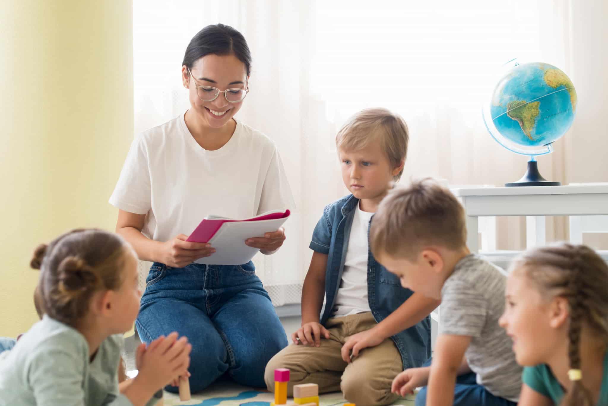 kindergarten-teacher-holding-notebook